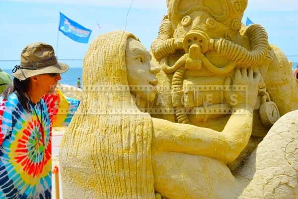 Atlantic city beach sand artist Damon Farmer working on his sand sculpture