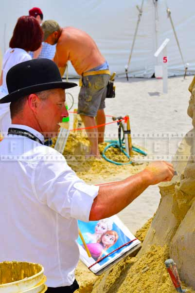 Sand artist sculpting