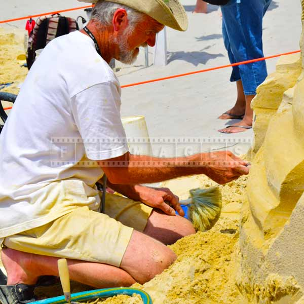 Canadian sand artist Peter Vogelaar creates his sand sculpture