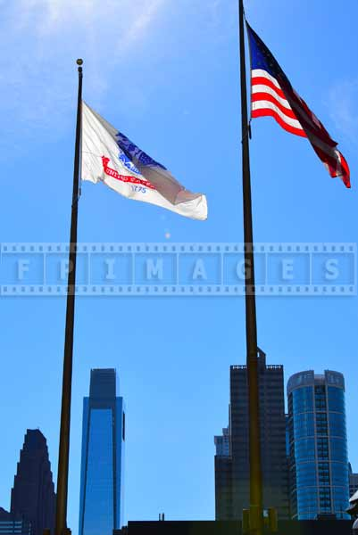 Philadelphia cityscapes with flags and tall buildings
