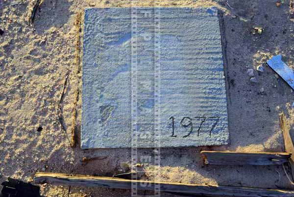 Abstract image with 1977 year written on concrete