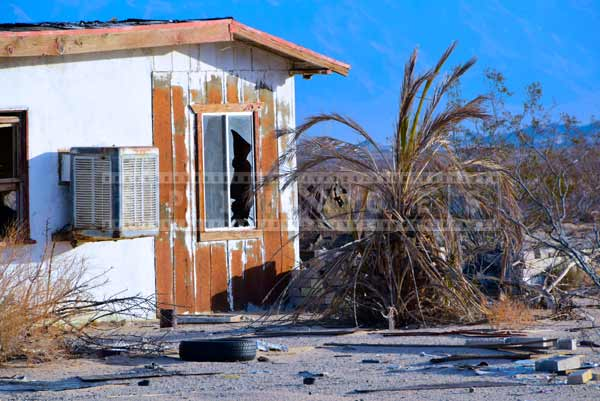 House falling apart in the desert. natural cycle abstract art photography
