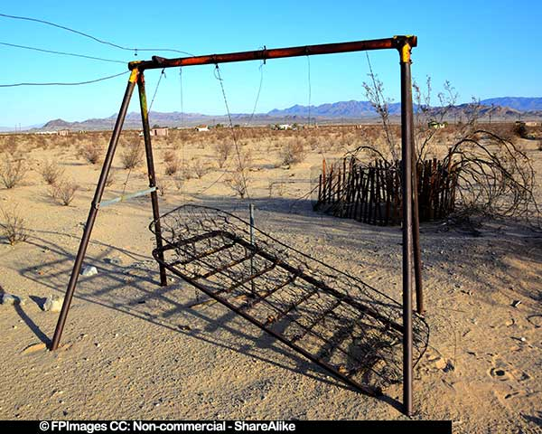Abstract images of an borken and decaying swing in the desert