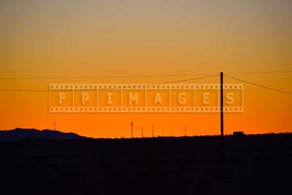 birght orange sky color in the desert at sunrise