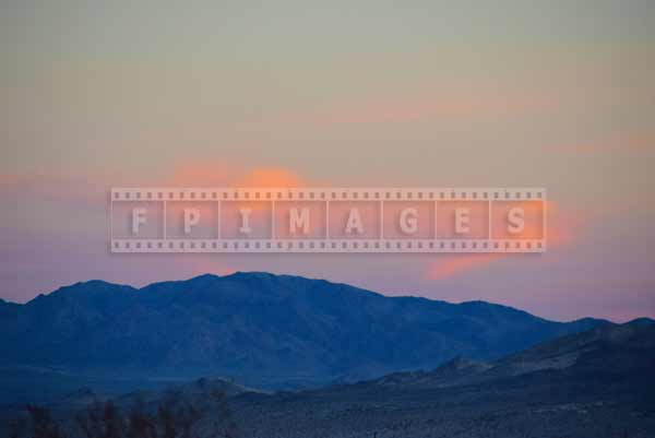 Desert landscape with pink clouds and mountains, Mojave desert travel images