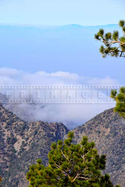 Mountain landscape - Clouds below in the valley