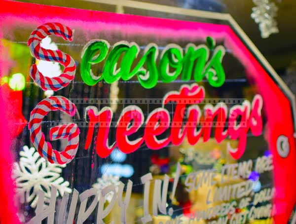 Season's greetings store window decorations