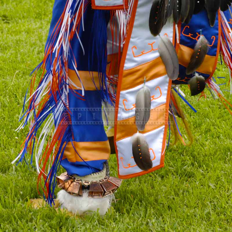 Details of dance regalia showing bright colors and native american hieroglyphs