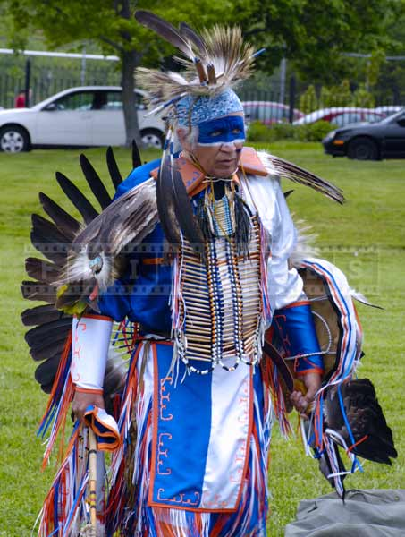 White and blue dance regalia of head dancer