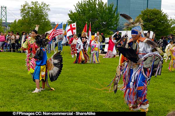 Male and female dancers at the start of powwow in Dartmouth