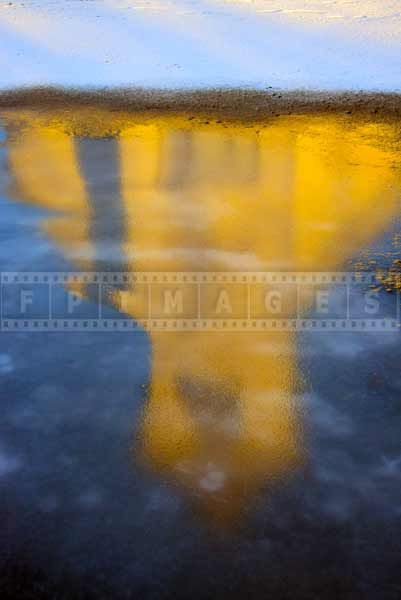 Morning reflections of the church in the ice - abstract art picture