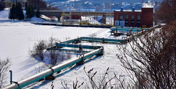 Pipeline near Madawaska river, industrial winter pictures