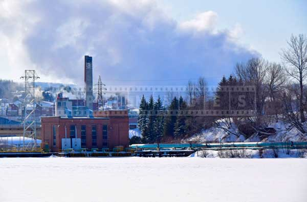 Steam rising from Madawaska paper mill