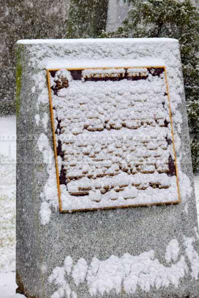 snow covered memorial plaque