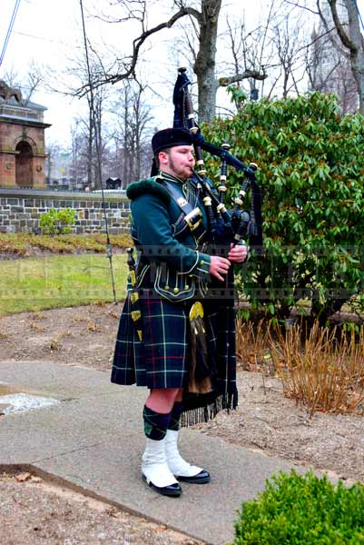 Bagpiper playing before the opening