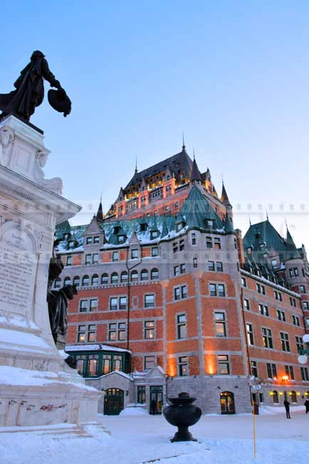Monument to S. Champlain and Chateau Frontenac at sunset