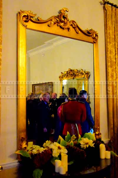 Mirror with golden frame and Christmas decorations