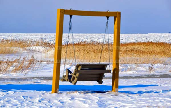 A swing by St. Lawrence river waiting for warmer times