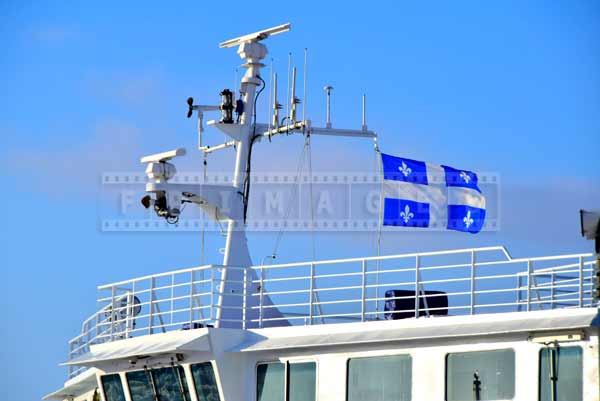 Main mast of the ferry flying Quebec flag