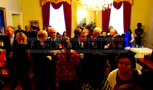 People enjoying reception at government house
