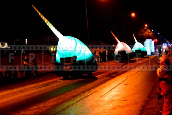 Alien mobiles glowing and colorful at night street parade