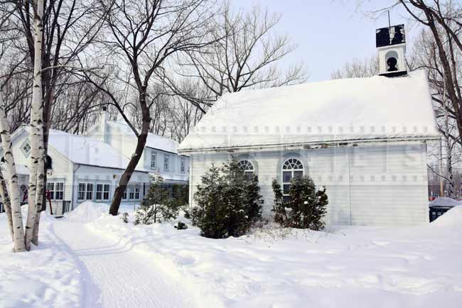 Smaller buildings near the pond, skate and snowshoe rentals