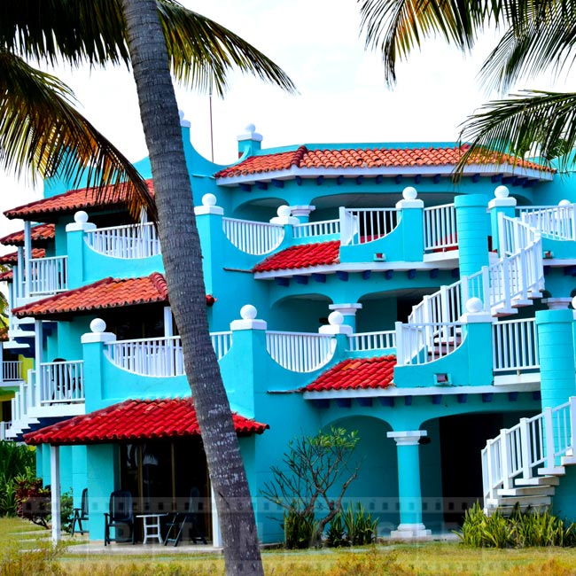 Blue hotel building and red roofs, Caribbean hotel architecture