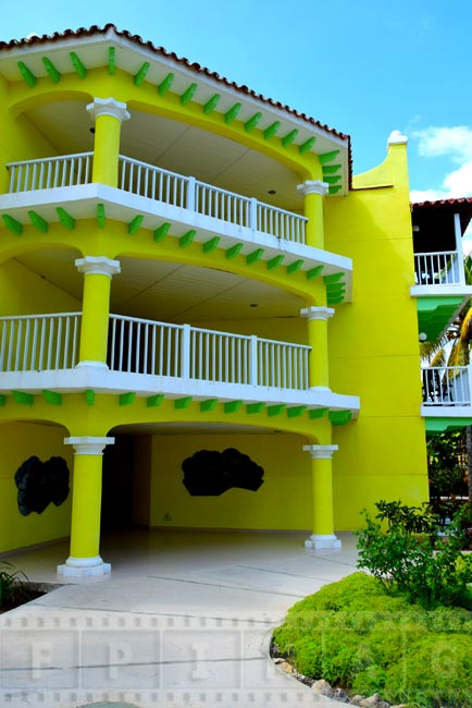 Yellow and green hotel building