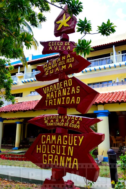 Colorful sign pointing to major Cuban cities