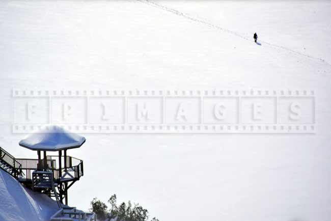 Winter picture of a panoramic stairway lookout and a person hiking