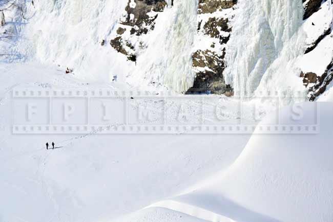 People walking hiking trail to Montmorency waterfall in winter