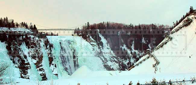 Chute Montmorency waterfall at sunset, winter landscape