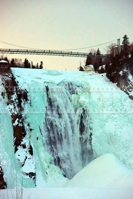 Sunset winter scenery, rushing water at Montmorency falls