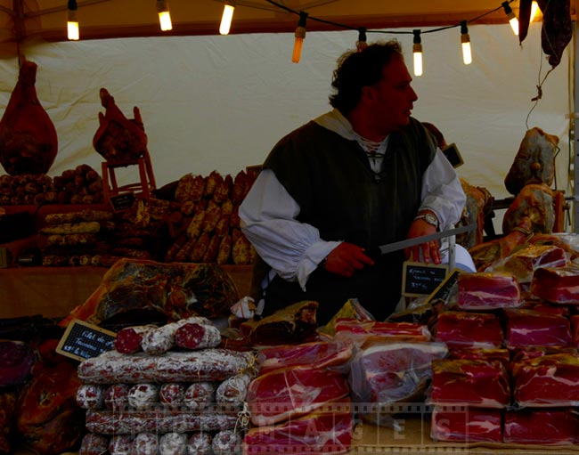 Farmer with the knife at the meat stand