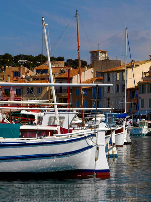 White and blue boats moored in Cassis harbour