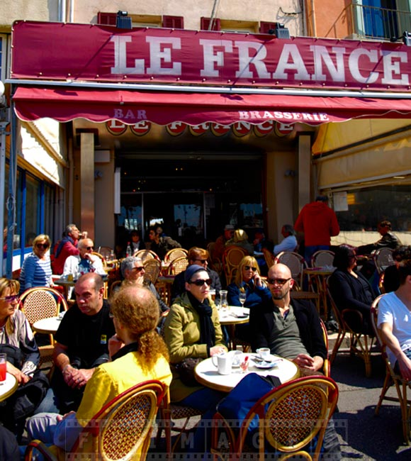 People enjoying spring day at Le France bar and brasserie