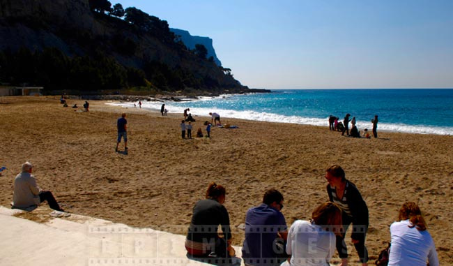 Cassis sandy beach, people enjoy the spring sun