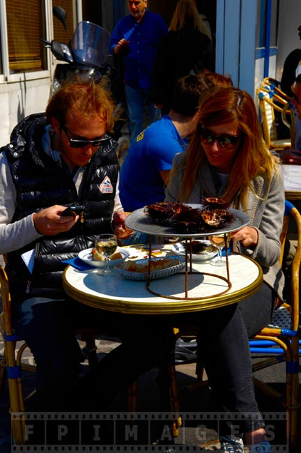 Tourists eating live sea urchins