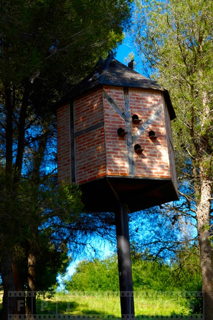Brick birdhouse in the forest