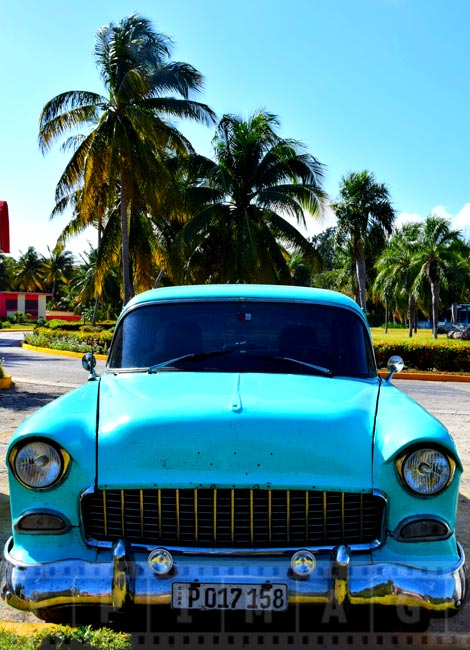 Old car of turquoise color just like Caribbean sea, 1950-s Chevrolet