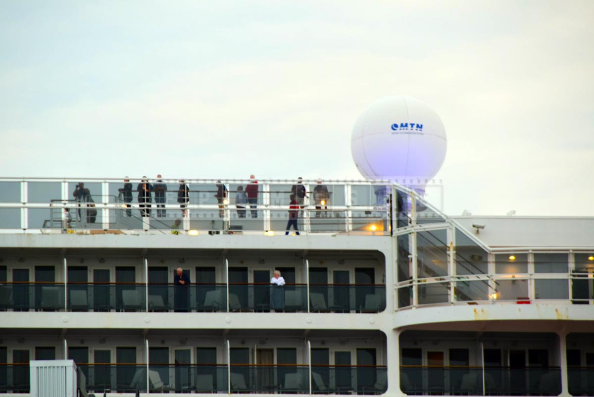 Passengers on decks of Queen Mary 2 cruise ship