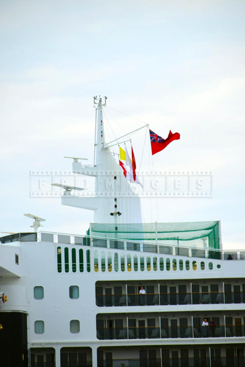 Flags flying on the main mast of QM2