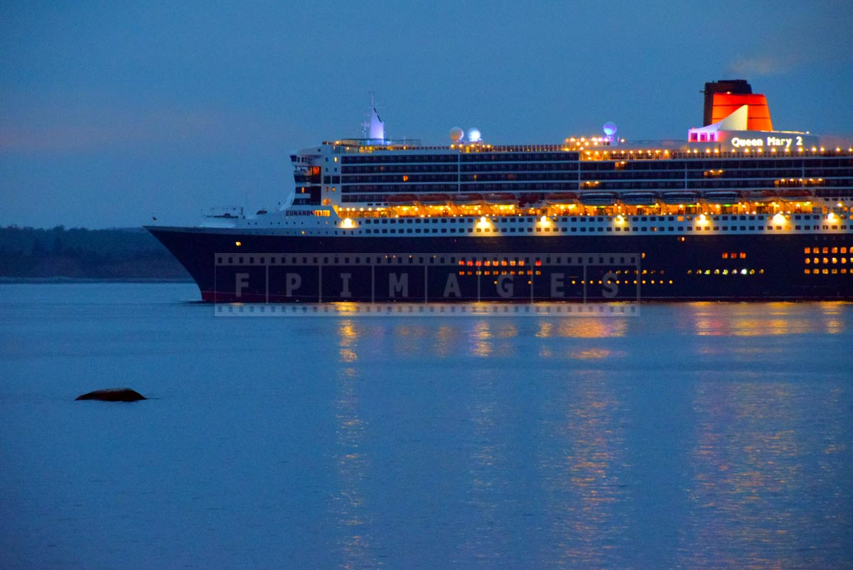 RMS Queen Mary 2 at morning dusk with lights, Halifax, NS