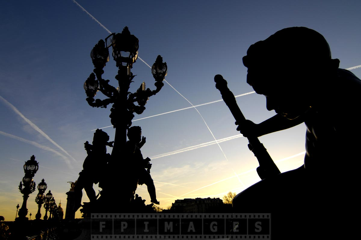 Awesome silhouettes of Alexander III bridge statues at sunset