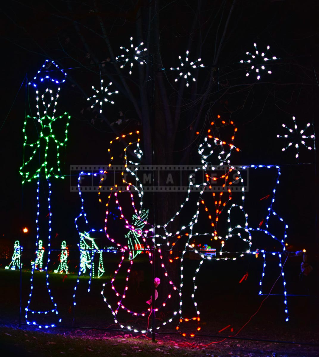 Romantic scene with a couple and snowflakes - holiday lights
