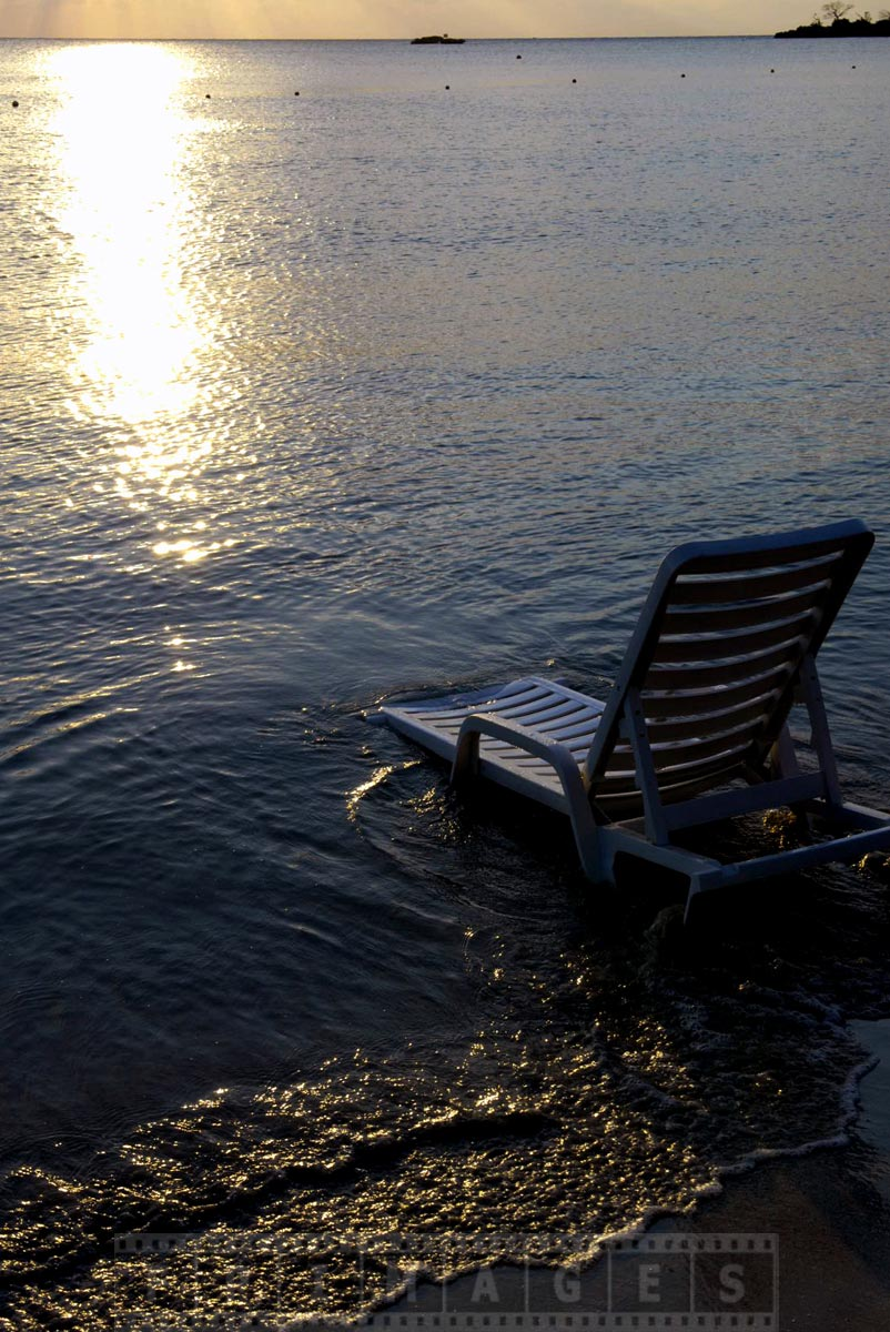 Enjoy romantic sunset in beach chaise lounge by the sea