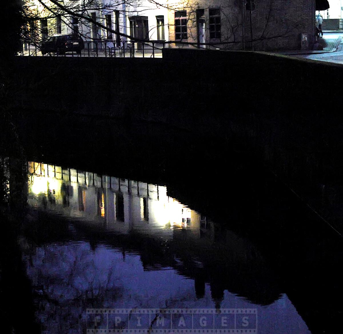 Bruges canal at night is quiet and peaceful