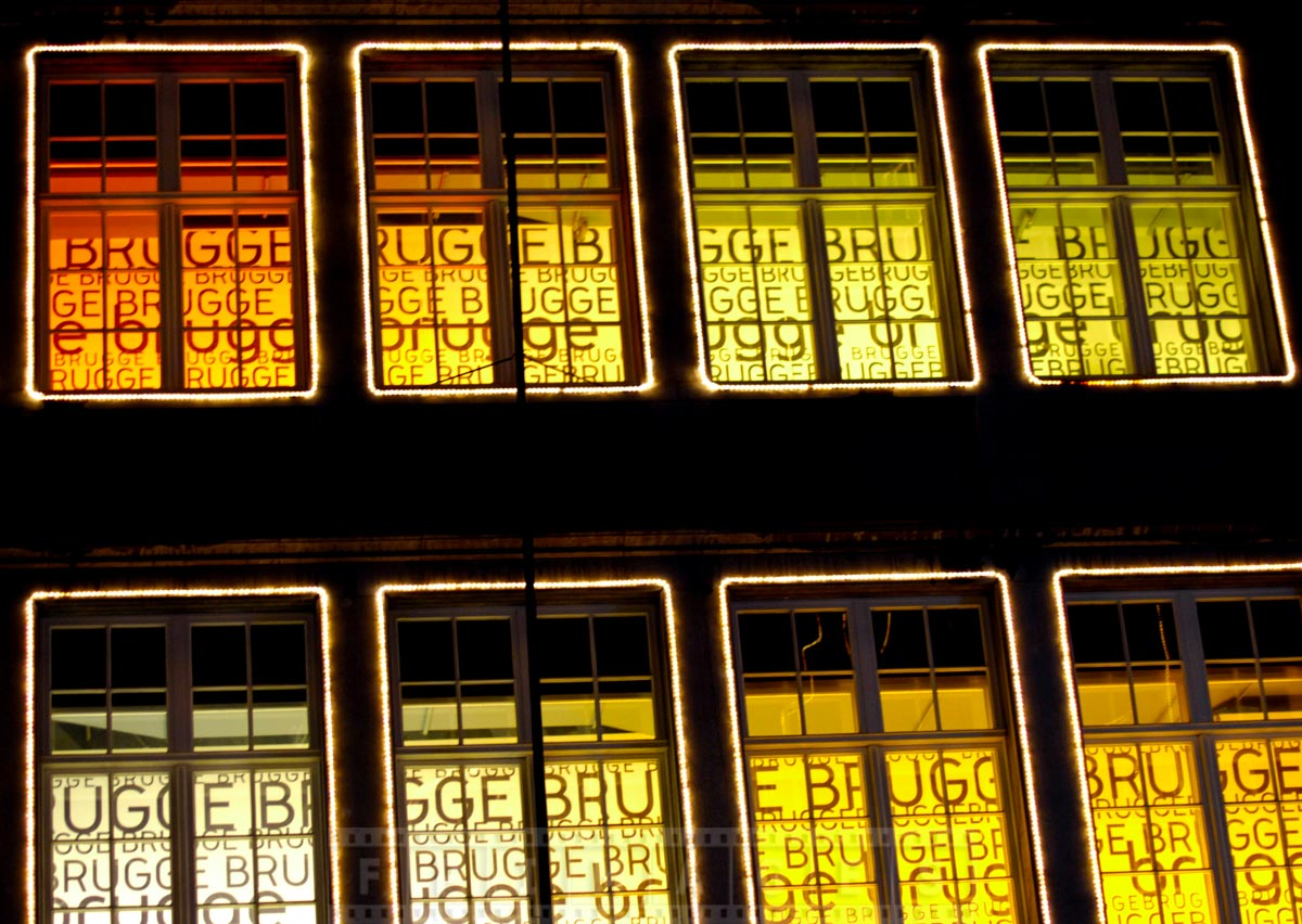 Windows decorations in Market square with the name of the town in Flemish - Brugge