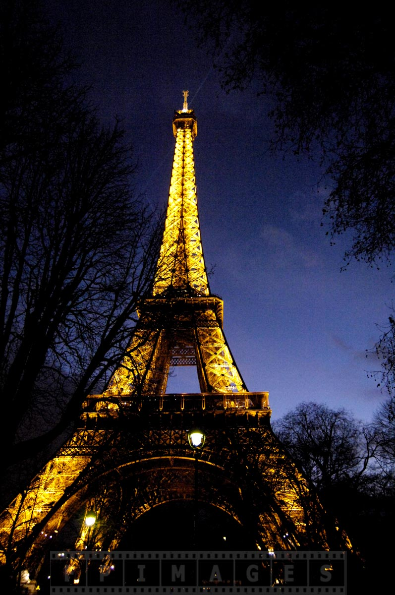 Tour Eiffel Tower at dusk with bright lights - most magic sight in Paris