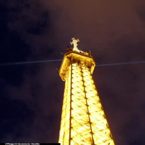 Eiffel Tower lit up at night is especially elegant and delightful